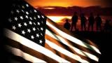 Military Soldiers behind US Waving Flag