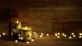 Candles And Cross With Christmas Lights On Wood Background Video
